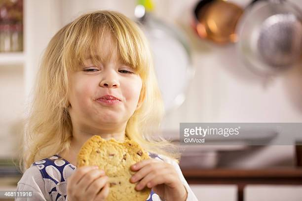 Little Girl Eating Chocolate Chip Cookie