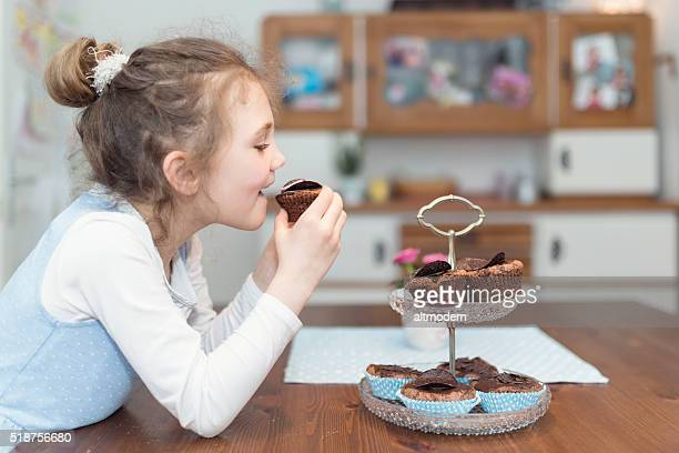 little girl eating cupcakes