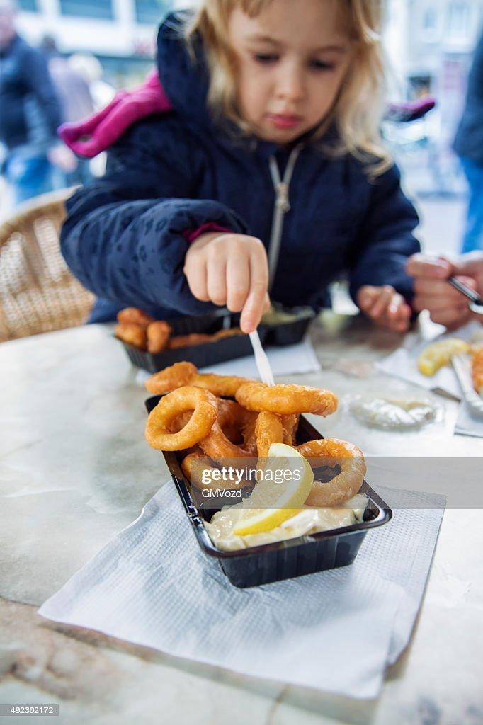 Little Girl Eating Fried Calamari Rings