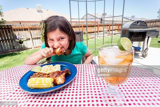 Little Girl Eating Fried Chicken