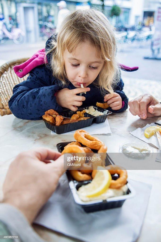 Little Girl Eating Kibbeling Fish