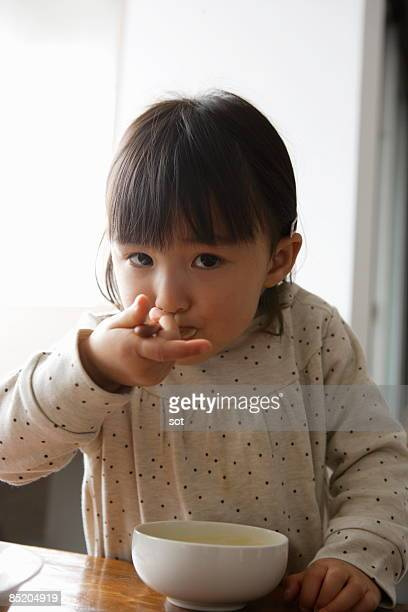 Little girl eating meal