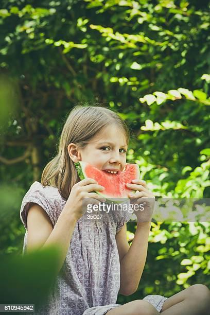 little girl eating melon