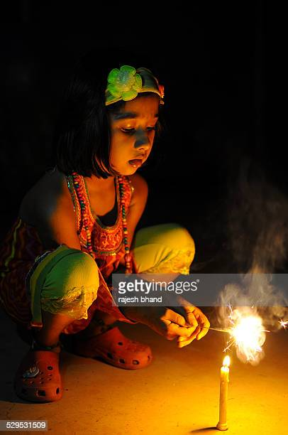 Little girl enjoying diwali