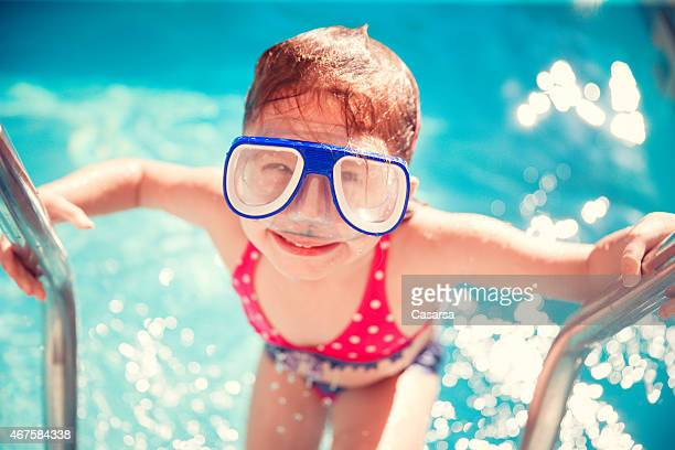Little girl exiting a swimming pool