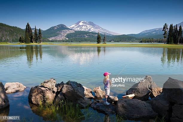 Little girl fishing at Sparks Lake, Oregon, USA