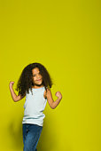 Little girl flexing muscles, portrait