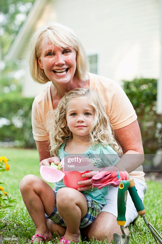 Little girl gardening with grandmother