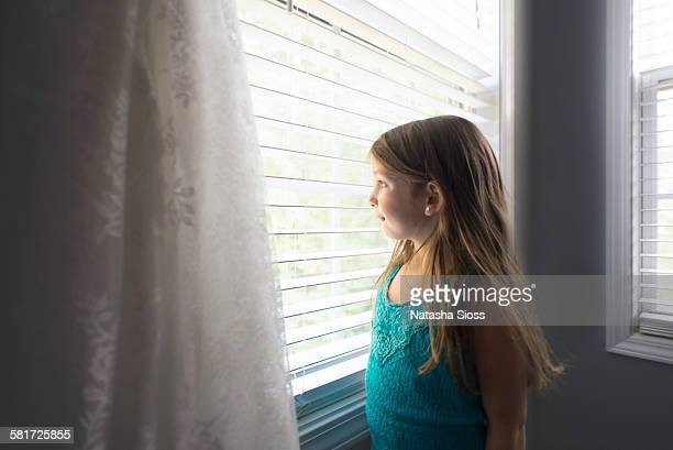 Little girl gazing out the window