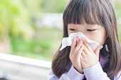 little girl get cold and blow her nose,  asian