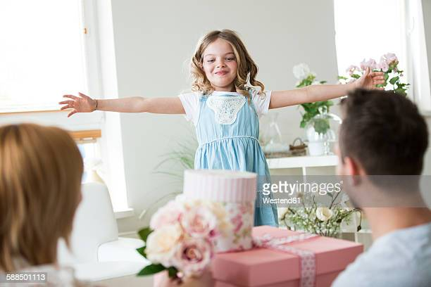 Little girl getting lots of presents for birthday