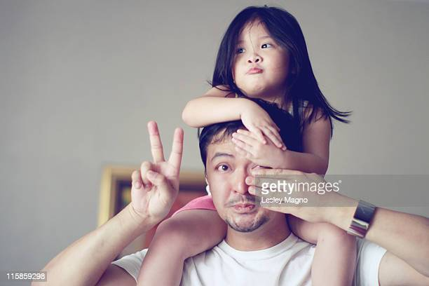 Little girl getting shoulder back ride