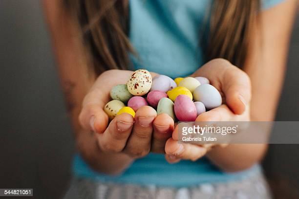 Little girl hands holding easter eggs