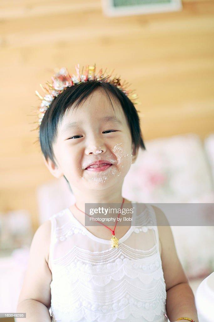 little girl happy to eat birthday cake3 : Stock Photo