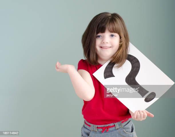 little girl has a question mark