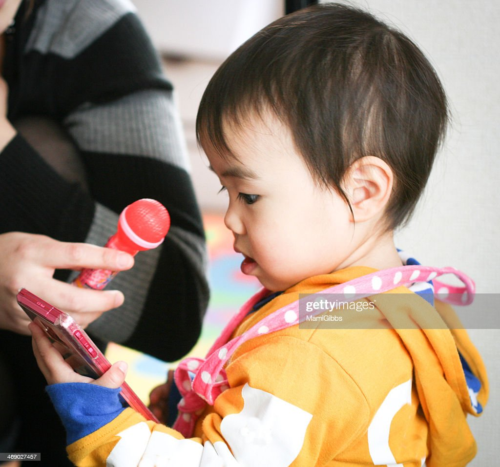 Little girl has a smart phone. : Stock Photo