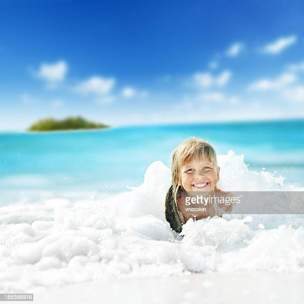 Little girl having fun in ocean