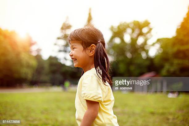 Little girl having fun in park, Tokyo.