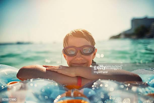 Little girl having fun in sea