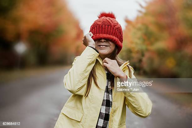 Little girl having fun outside in autumn