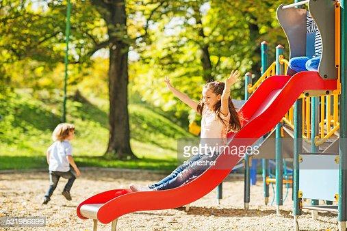 Little girl having fun while sliding.