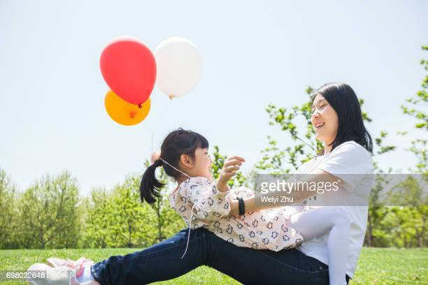 Little girl having fun with her mum