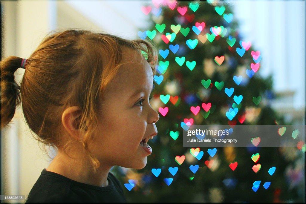 Little girl heart bokeh : Stock Photo