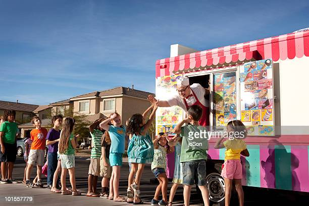 Little girl high-fiving ice cream vendor, kids wai