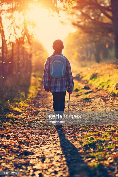 Little girl hiking in autumn