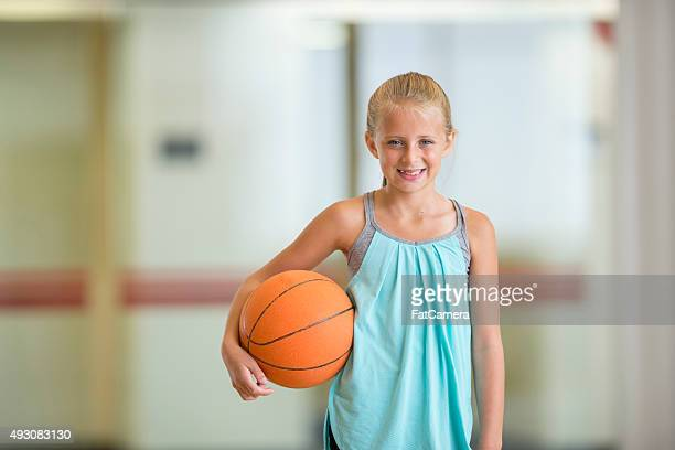 Little Girl Holding a Basketball