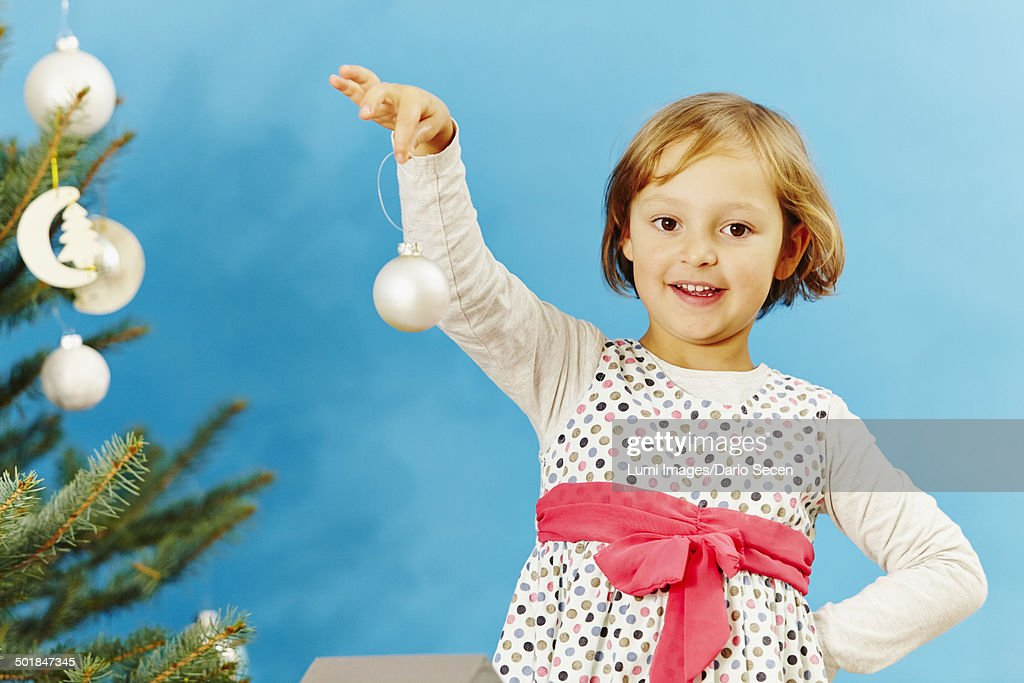 Christmas Baubles Germany : Little girl holding christmas bauble munich bavaria