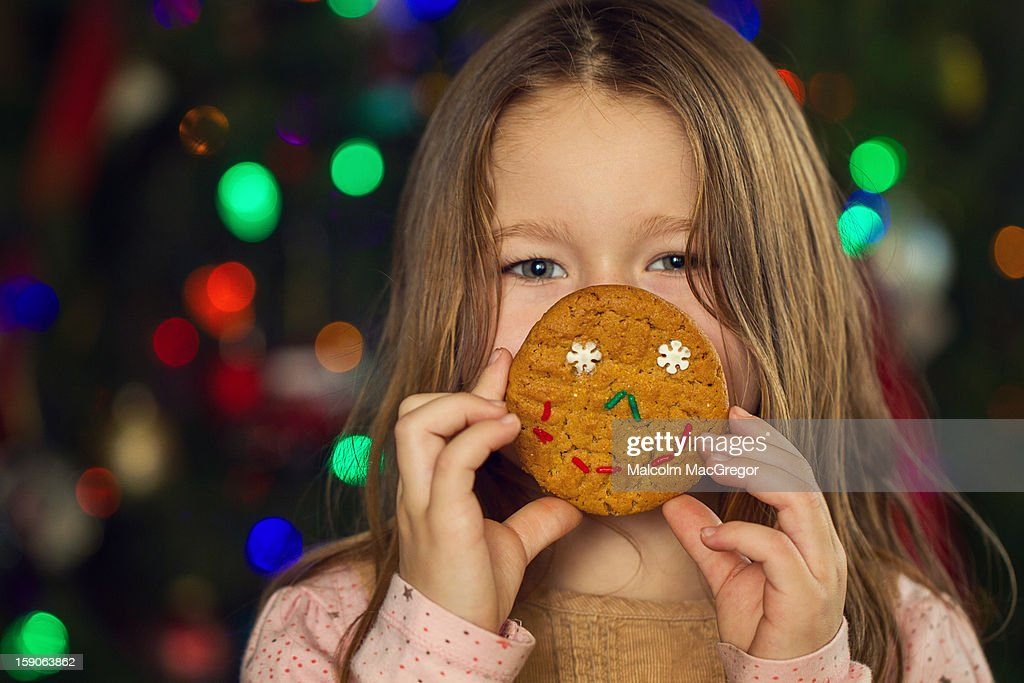Little Girl Holding Christmas Cookie : Stock Photo