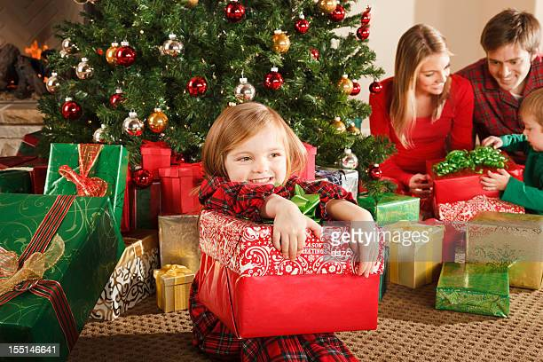 Little Girl Holding Christmas Gift