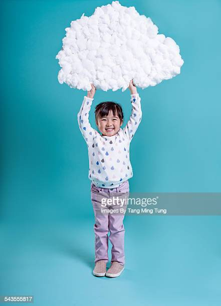 Little girl holding DIY data cloud over her head