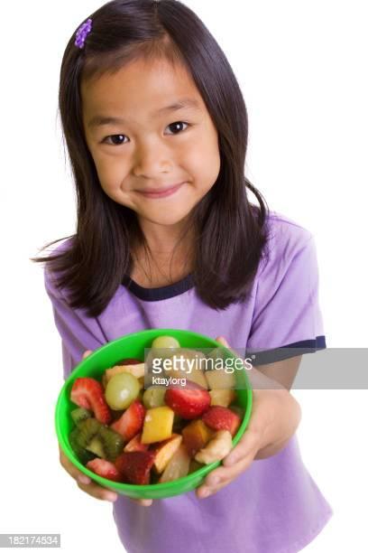 Little girl holding fruit salad