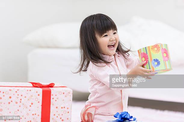 Little Girl Holding Gift