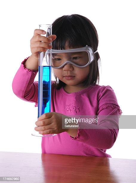 Little Girl Holding Graduated Cylinder with Chemical