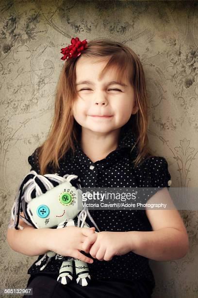 Little girl holding her stuffed doll