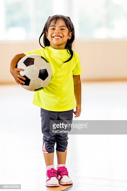 Little Girl Holding Soccer Ball