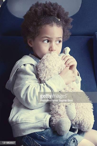 Little girl holding stuffed toy, portrait