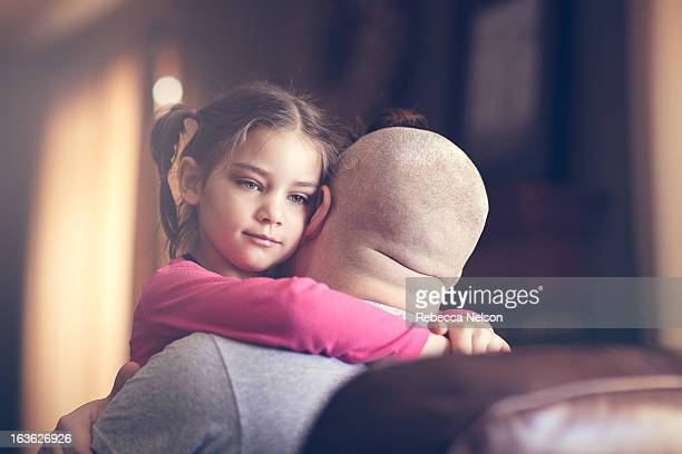 little girl hugging her dad