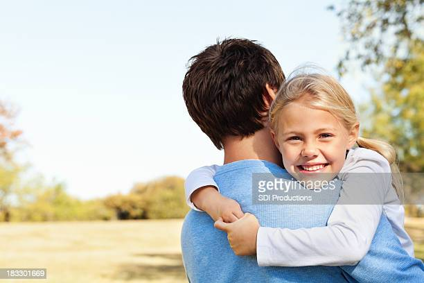 Little Girl Hugging Her Daddy