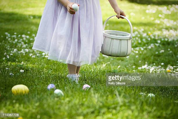 Little girl hunting for Easter eggs