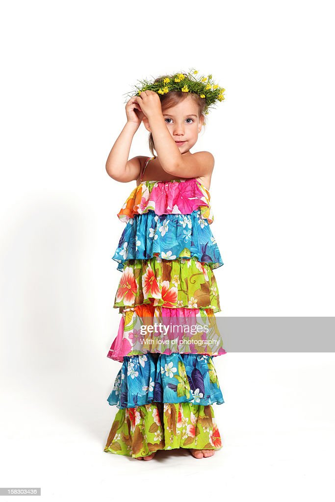 Little Girl In A Bright Summer Dress Stock Photo