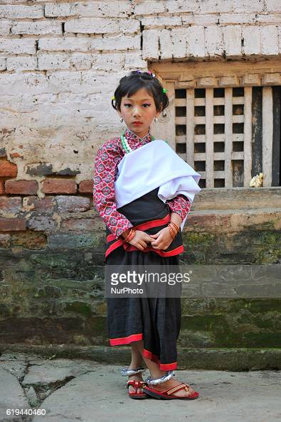A Little girl in a traditional attire participate in the parade of Nhu Dan which falls on Tihar or Deepawali and Dewali Festival of Lights at...