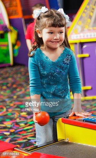 Little Girl in an Amusement Arcade