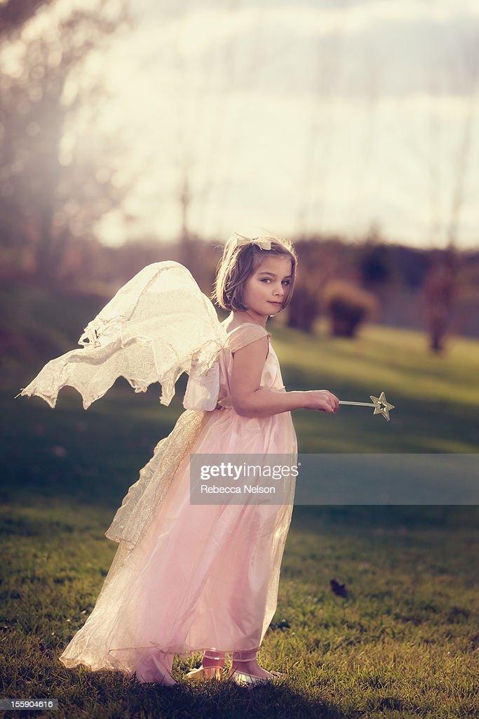Little girl in angelic fairy costume