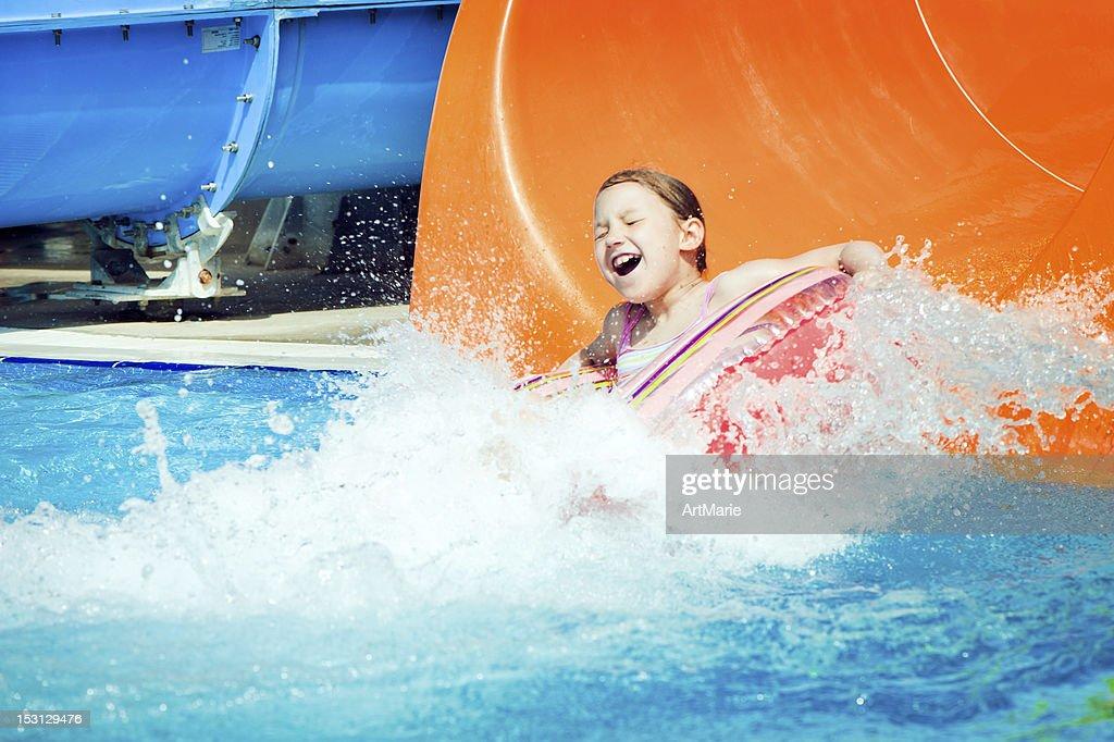 Little girl in aquapark : Stock Photo
