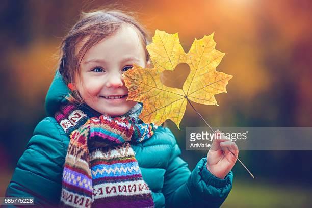 Little girl in autumn park