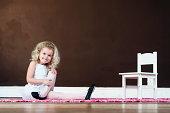 Little girl in ballet suit